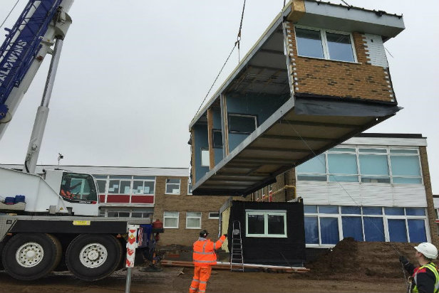Lifting modular school building units into place